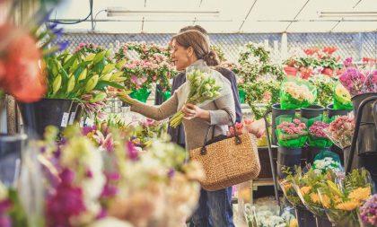 A couple chooses flowers in a florist's shop.